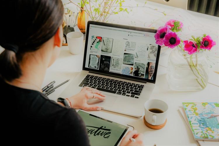 Woman designing logos at her desk